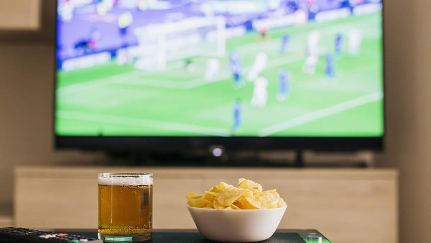 futebol e churrasco com amigos